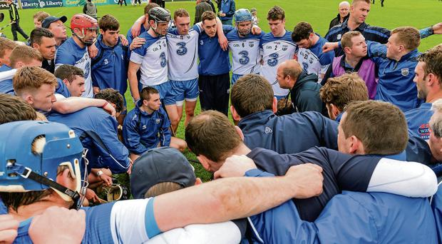 Waterford manager Derek McGrath speaks to his players after the game at Semple Stadium Diarmuid Greene / SPORTSFILE