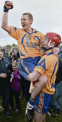 Ollie Canning is lifted by his brother Joe after Portumna's victory in the Galway club SHC final DIARMUID GREENE/ SPORTSFILE
