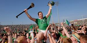 Niall Moran is carried shoulder-high by Limerick supporters following the Munster final
