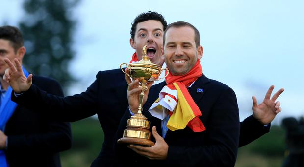 Europe's Sergio Garcia (front) and Rory McIlroy pose with The Ryder Cup on day three of the 40th Ryder Cup at Gleneagles Golf Course, Perthshire. PRESS ASSOCIATION Photo. Picture date: Sunday September 28, 2014. Photo credit should read: Lynne Cameron/PA Wire. RESTRICTIONS: Use subject to restrictions. Editorial use only. No commercial use. Call +44 (0)1158 447447 for further information.