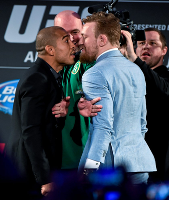 Conor McGregor facing off to his rival Jose Aldo in 2015