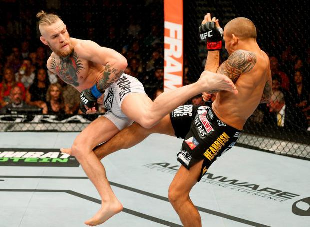 Conor McGregor (on left) in action last year against Dustin Poirier in Nevada