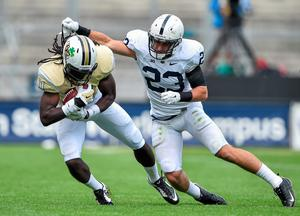 Breshad Perriman, University of Central Florida, gets possession ahead of Penn State Safety Ryan Keiser