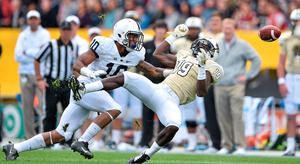 University of Central Florida, Wide Receiver, Josh Reese, fails to catch a pass under pressure from Penn State, Cornerback, Trevor Williams