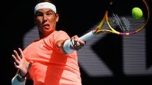 Spain's Rafael Nadal hits a forehand return to during his fourth round match against Italy's Fabio Fognini at the Australian Open in Melbourne. Photo: Andy Brownbill/AP