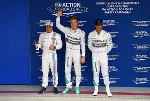 Nico Rosberg celebrates next to Lewis Hamilton and Felipe Massa after claiming pole position during qualifying for the Brazilian Formula One Grand Prix