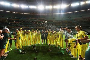 The Australian Team celebrate after the 2015 ICC Cricket World Cup final match between Australia and New Zealand