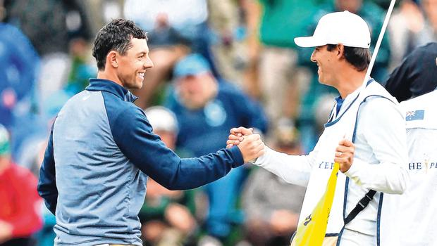 Rory McIlroy and caddy Harry Diamond celebrate after the Holywood star's victory at Sawgrass. Photo: Getty
