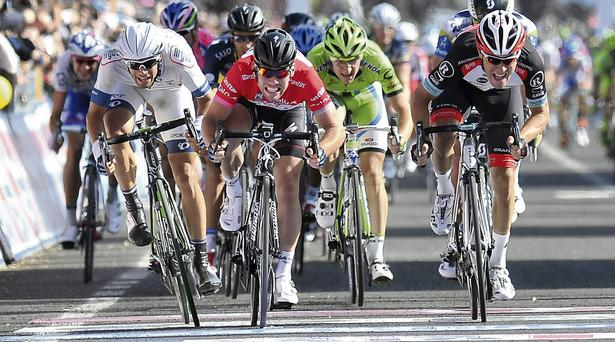 Britain's Mark Cavendish, center, sprints to win the 13th stage of the 2013 Giro d'Italia, Tour of Italy cycling race, from Busseto to Cherasco.