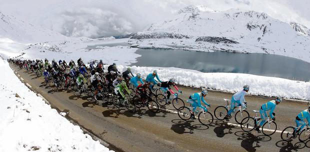 The peloton climbs during yesterday's 146km 15th stage of the Giro d'Italia, from Cesana to Col du Galibier