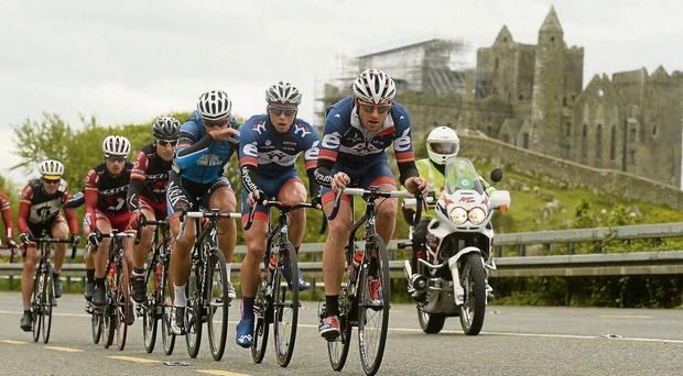 The peloton passes by the Rock of Cashel during Stage 6 of the An Post Rás from Mitchelstown to Carlow