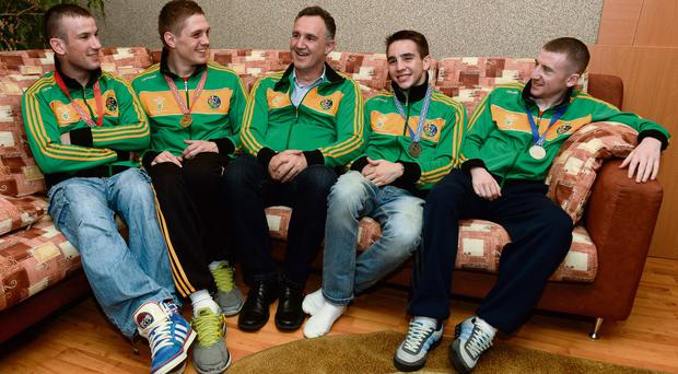 Gold medal winners John Joe Nevin and Jason Quigley, and silver medal winners Michael Conlan and Paddy Barnes, with coach Billy Walsh in Minsk