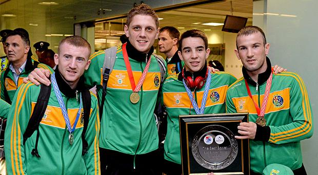 Team Ireland boxers, from left, Paddy Barnes, silver medal in 49Kg Light Flyweight division, Jason Quigley, gold medal in 75Kg Middleweight division, Michael Conlan, silver medal in 52Kg Flyweight division, and John Joe Nevin, gold medal in 56kg Bantamweight division, on their arrival home