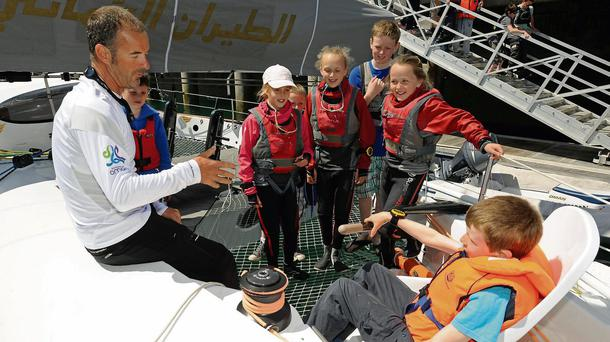 Damian Foxall gives advice to some budding sailors at Dun Laoghaire