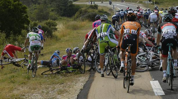 Jerome Coppel of France, left in red jersey, crashes during the fifth stage of the Tour de France