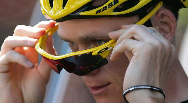 Race leader yellow jersey holder Team Sky rider Christopher Froome of Britain