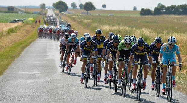 Nicolas Roche (second right) leads the Saxo-Tinkoff charge to create the crucial split from the Yellow Jersey group during yesterday's stage 13 of the Tour de France.