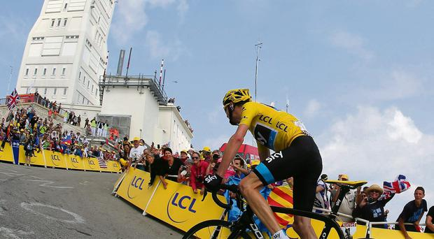 Sky's Chris Froome rides up the final slopes of Mont Ventoux after a devastating climb to extend his lead in the overall classifications.