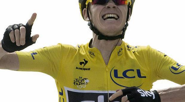 Chris Froome celebrates as he crosses the line to win stage 15 of the Tour de France