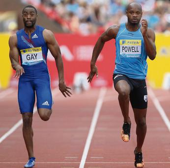 Tyson Gay (L) and Asafa Powell