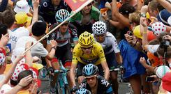 Race leader Yellow jersey holder Team Sky rider Christopher Froome of Britain cycles among a group of riders climbing the Alpe d'Huez mountain