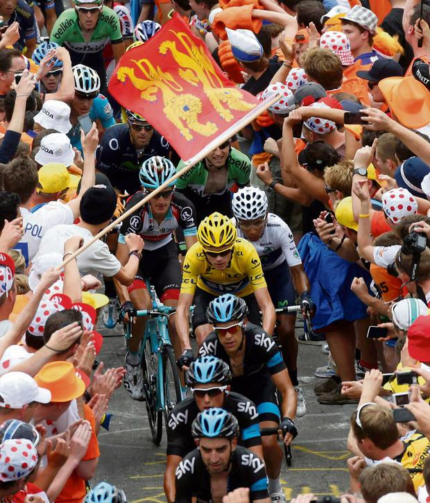 Race leader Yellow jersey holder Team Sky rider Christopher Froome of  Britain cycles among a group 703572dbf