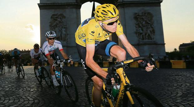 Chris Froome powers past the Arc de Triomphe on the final stage as he coasts to overall victory in the Tour de France