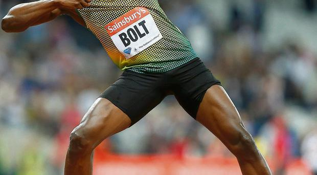 Usain Bolt strikes a familiar pose after winning the 100m race in London last night