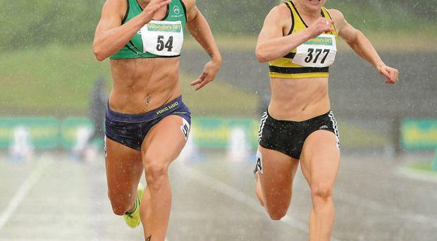 Kelly Proper of Ferrybank (left) holds off the challenge of Leevale's Ailis McSweeney on her way to winning the Women's 100m event in the rain at Morton Stadium yesterday