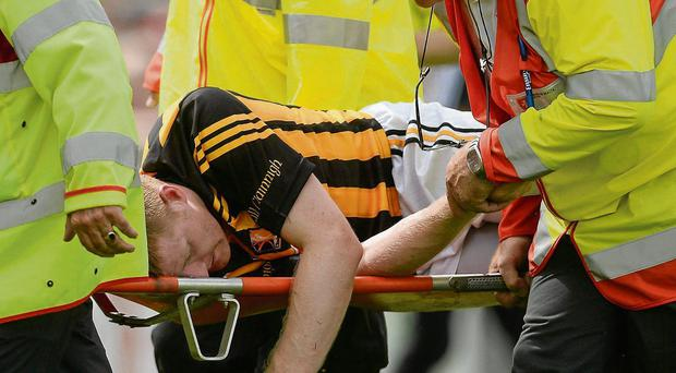 Kilkenny's Richie Power is stretchered off after suffering concussion in the All-Ireland SHC quarter-final against Cork this year; doctors have warned of the dangers of concussion