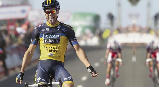 Nicolas Roche celebrates after crossing the line to win Stage Two of the 'Vuelta' cycling race between Pontevedra and Alto Do Monte Da Groba