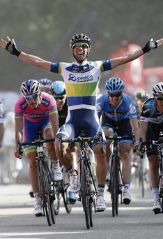 Australian rider Michael Matthews of the Orica-GreeEdge team celebrates his victory at the end of the fifth day of the Tour of Spain, a 174.3 km stage between Sober and Lago de Sanabria