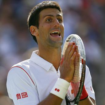 Novak Djokovic reacts during his epic semi-final win over Stanislas Wawrinka