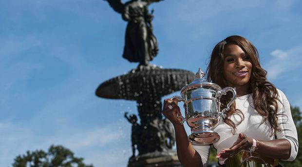 Serena Williams poses with the US Open tropy in New York's Central Park after winning the women's final match against Victoria Azarenka of Belarus - a victory that takes her career Grand Slam title total to 17