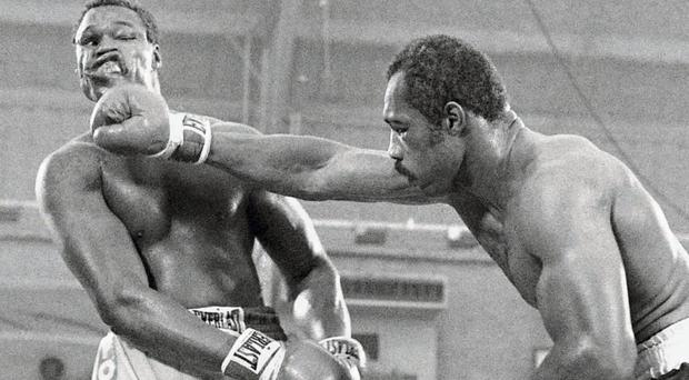 Ken Norton lands a blow on Larry Holmes during the 1978 fight which Holmes won on a split decision