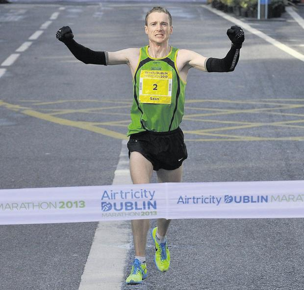 Sean Hehir of Rathfarnham WSAF crosses the line to win the men's race in a time of 2.18.19.