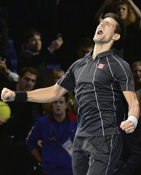 Novak Djokovic shows his delight after defeating Rafa Nadal in London last night to clinch victory in the World Tour Finals