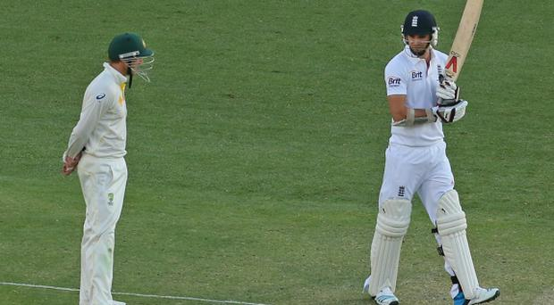 James Anderson of England and George Bailey (L) of Australia exchange words during day four of the First Ashes Test match between Australia and England