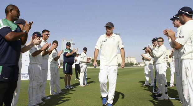 Ireland's Trent Johnston is applauded by his team-mates as he leaves the field after his last match for Ireland following their ICC Intercontinental Cup final victory over Afghanistan in Dubai