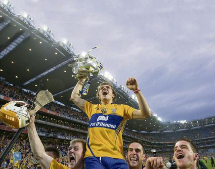 Clare goalscorer Shane O'Donnell is lifted by his team-mates as they celebrate with the Liam MacCarthy Cup Brendan Moran / SPORTSFILE