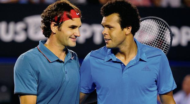 Roger Federer is congratulated by Jo-Wilfried Tsonga after advancing to the Australian Open quarter-final
