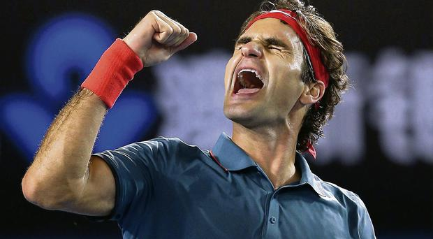 Switzerland's Roger Federer celebrates beating Andy Murray in the Australian Open