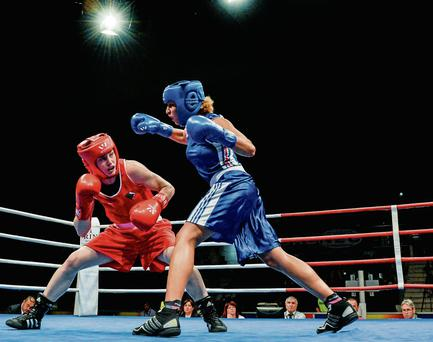 Katie Taylor, Ireland, exchanges punches with Estelle Mossley, France, right.