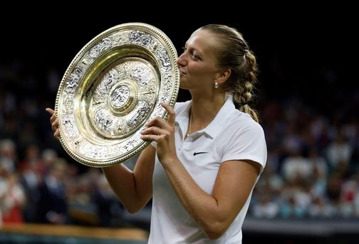 Petra Kvitova celebrates her victory over Eugenie Bouchard in the women's singles final at Wimbledon yesterday