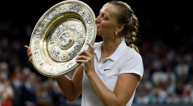 Petra Kvitova celebrates her victory over Eugenie Bouchard in the women's singles final at Wimbledon