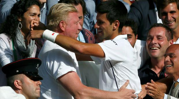 Novak Djokovic celebrates with Boris Becker after winning Wimbledon in 2014
