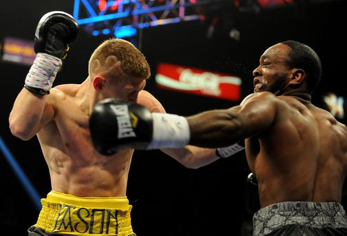 Jason Quigley (left) and Howard Reece exchange blows during a middleweight fight at MGM Grand in Las Vegas