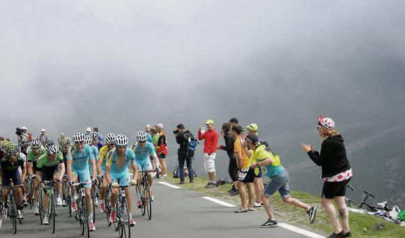 Riders make their way up the Col du Tourmalet during the 18th stage of the Tour de France