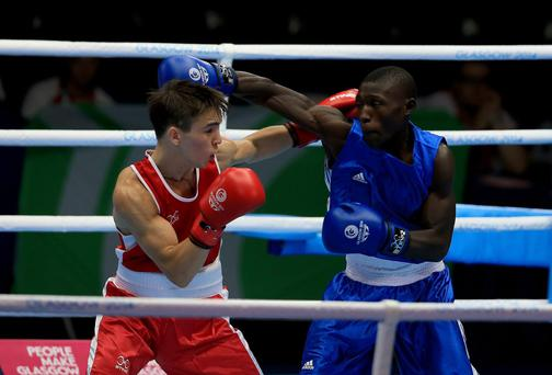 Northern Ireland's Michael Conlan (red) in action against Uganda's Bashir Nasir in the Men's Bantam (56kg) Quarter-final 1 match at the 2014 Commonwealth Games