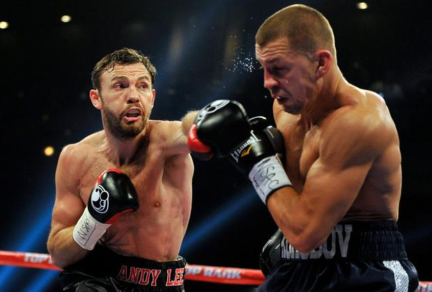 Andy Lee (L) throws a left at Matt Korobov during their fight for a vacant WBO middleweight title at The Chelsea at The Cosmopolitan of Las Vegas